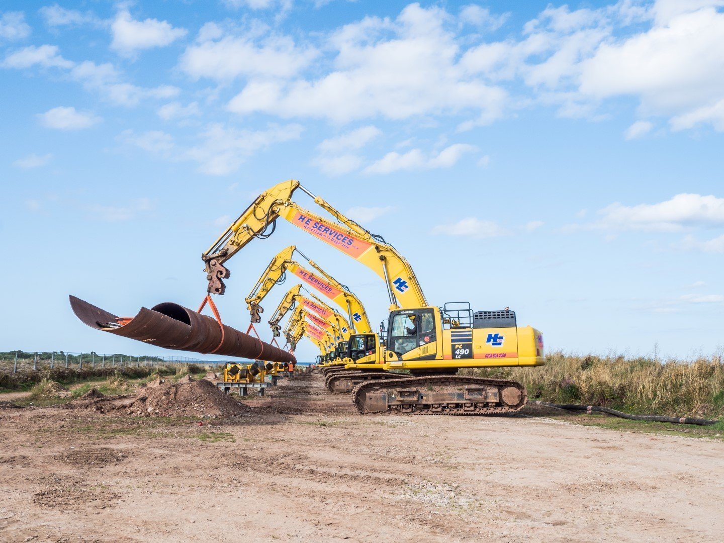 Drill line being supported by excavators ©Stockton Drilling